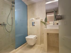 A bathroom at Koukounaria Hotel & Suites