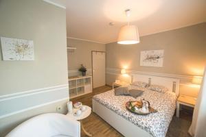 Ein Bett oder Betten in einem Zimmer der Unterkunft B&B Lakeview