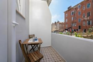 A balcony or terrace at La Preziosa Rooms