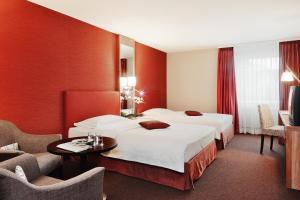 Ein Bett oder Betten in einem Zimmer der Unterkunft Mövenpick Hotel Egerkingen