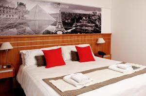 A bed or beds in a room at Catamarca Suites Land