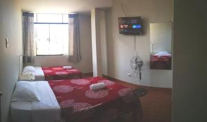 A bed or beds in a room at HOSTAL VEGAS
