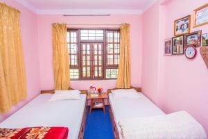 Een bed of bedden in een kamer bij Panauti Community Homestay