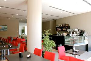 A restaurant or other place to eat at Tag Hotel