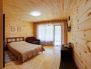 Кровать или кровати в номере Гостевой дом Классика