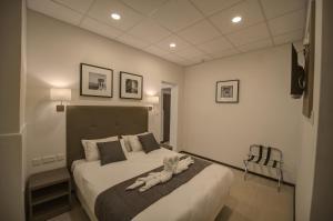 Cama o camas de una habitación en Europa Hotel