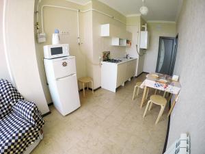 A kitchen or kitchenette at Квартира на Крымской