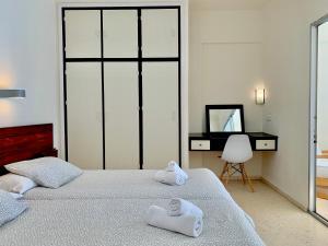 Cama o camas de una habitación en Apartamentos Playa Torrecilla