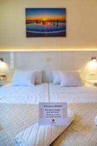 A bed or beds in a room at Idassa Atrium