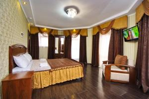 A bed or beds in a room at Kastro
