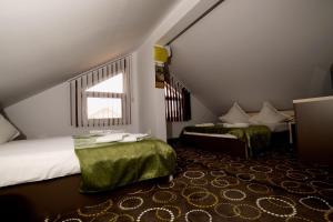 Un pat sau paturi într-o cameră la Vila Pretty Woman