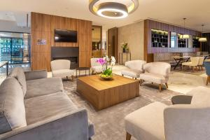The lobby or reception area at Luxury Hotel Riva