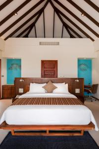 A bed or beds in a room at VARU by Atmosphere - Premium All Inclusive with Free Transfers