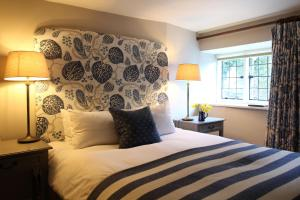 A bed or beds in a room at The Lamb Inn