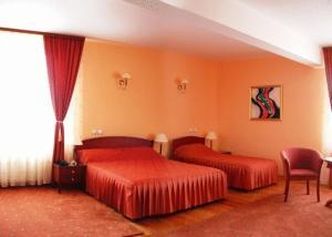 Un pat sau paturi într-o cameră la Hotel Maria