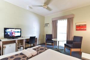 A television and/or entertainment center at Big Windmill Corporate & Family Motel