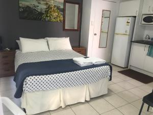 A bed or beds in a room at Dover Motel
