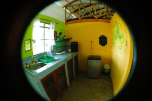 A kitchen or kitchenette at Ciao Cacao Hostel & Vegan Cafe