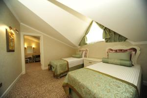 A bed or beds in a room at Grand Gocek Hotel