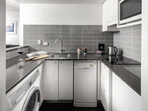 A kitchen or kitchenette at The Sebel Brisbane