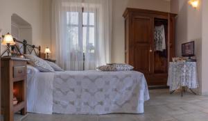 Letto o letti in una camera di Il Borgo B&B
