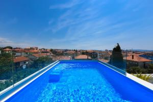 The swimming pool at or near Luxury Rooms LaVie