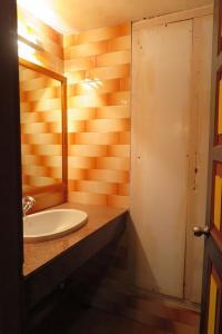 A bathroom at Olathang Hotel