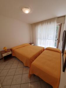 Postel nebo postele na pokoji v ubytování Residence La Zattera
