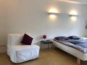 A bed or beds in a room at Cozy apartment pl.Solny