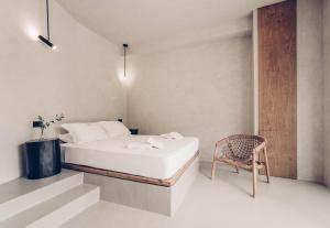 A bed or beds in a room at Monastery Estate Retreat