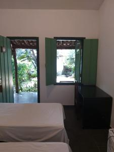 A bed or beds in a room at Pousada do Ipe