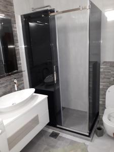Ванная комната в Belvedere Apartments
