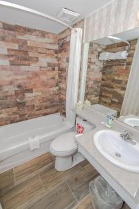 A bathroom at Canadas Best Value Inn Chinook Station