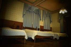 A bed or beds in a room at Capital Plaza Hotel