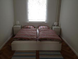 Ein Bett oder Betten in einem Zimmer der Unterkunft Apartment Villa Elisa