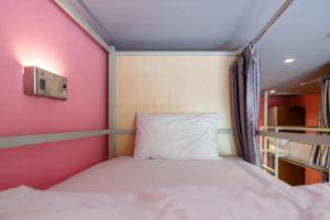 A bed or beds in a room at Siamaze Hostel