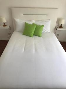 A bed or beds in a room at 7 Rivers Hostel
