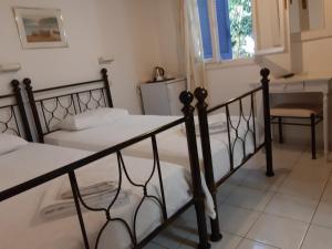 Ένα ή περισσότερα κρεβάτια σε δωμάτιο στο Pergola Hotel