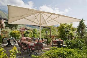 Ein Restaurant oder anderes Speiselokal in der Unterkunft Residence Kronenwirt