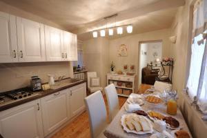 Cucina o angolo cottura di B&B Sant'Agostino