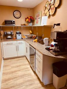 A kitchen or kitchenette at Anchorage Downtown Hotel