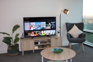 A television and/or entertainment center at Stunning Views Sydney Olympic Park