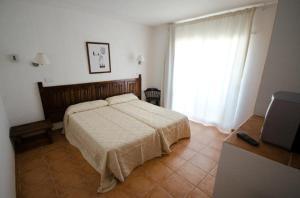 Ein Bett oder Betten in einem Zimmer der Unterkunft Hotel Club Can Jordi