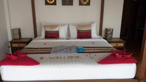 A bed or beds in a room at Koh Phangan Pavilions