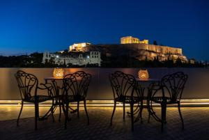 A balcony or terrace at Acropolis View Hotel