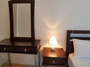 Ένα ή περισσότερα κρεβάτια σε δωμάτιο στο Δωμάτια Διονυσία