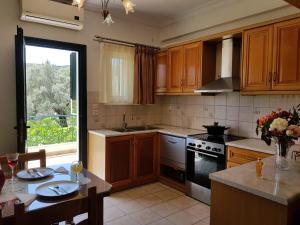 Η κουζίνα ή μικρή κουζίνα στο Δωμάτια Διονυσία