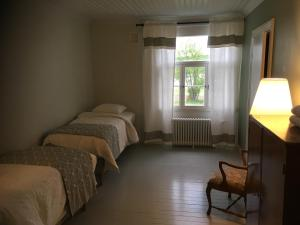 A bed or beds in a room at Guesthouse Kumpunen