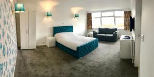 A bed or beds in a room at The Highfield Hotel