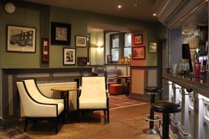 The lounge or bar area at Schooner Hotel